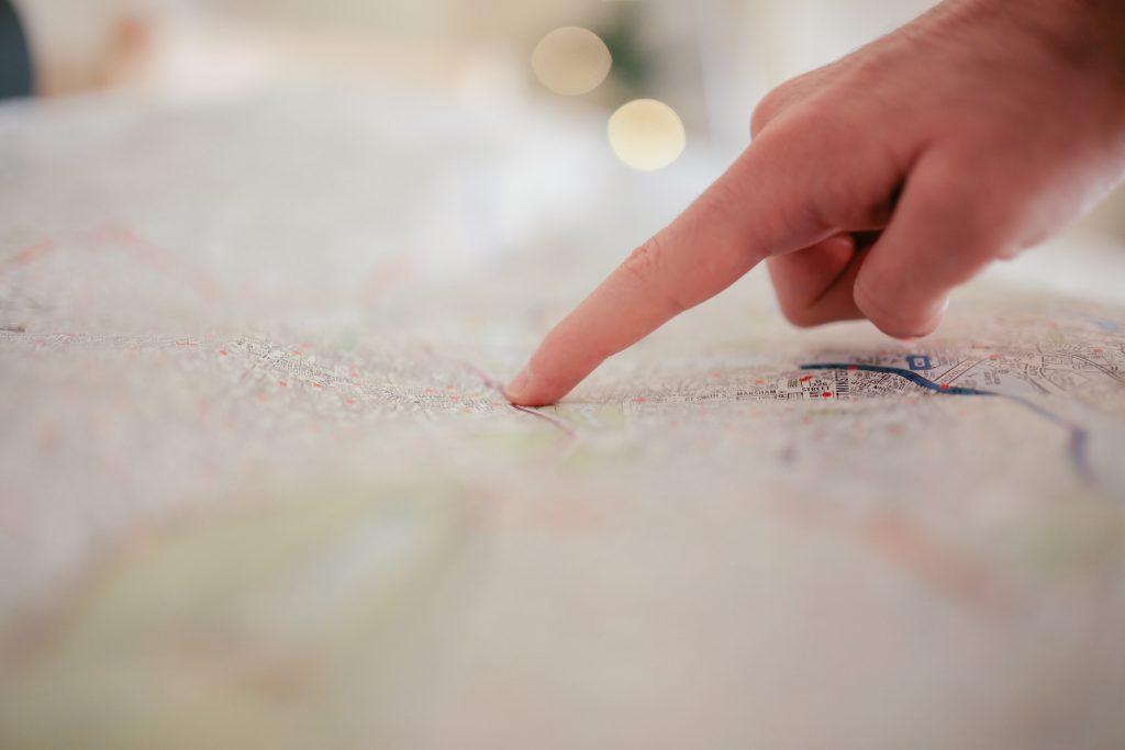 person-pointing-on-white-textile-34753